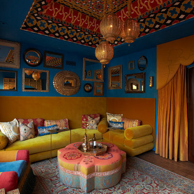 Inspiration for a mediterranean enclosed dark wood floor family room remodel in Phoenix with blue walls, no fireplace and no tv