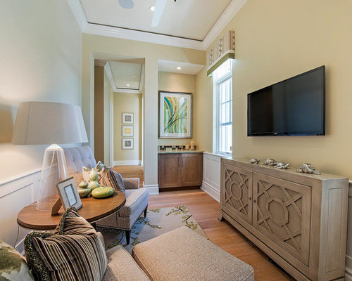 Small Transitional Enclosed Medium Tone Wood Floor And Brown Family Room Photo In Miami With