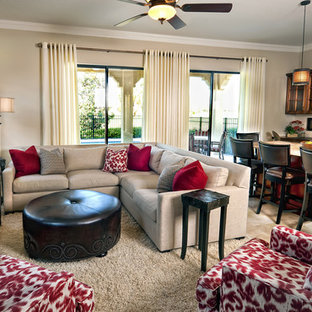 Inspiration for a contemporary open concept carpeted family room remodel in Orlando with beige walls, no fireplace and a wall-mounted tv