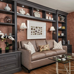 Family room - mid-sized transitional dark wood floor family room idea in Miami with brown walls and no fireplace