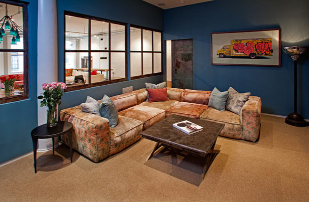 Industrial Family Room by threshold interiors