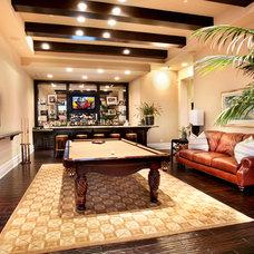 Tropical Family Room by Legacy Custom Homes,Inc.