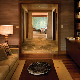 Inspiration for a tropical family room remodel in Hawaii with beige walls