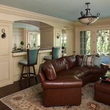 Tropical Family Room by CBI Design Professionals, Inc.