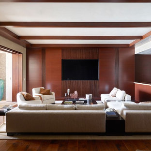 Island style open concept medium tone wood floor family room photo in Orange County with no fireplace and a wall-mounted tv