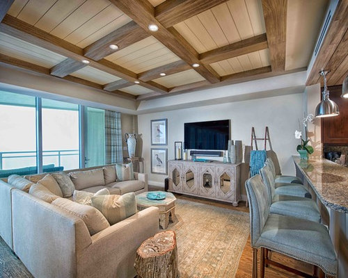 Mid Sized Island Style Open Concept Medium Tone Wood Floor And Brown Floor  Family Room