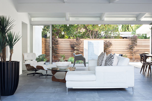 Midcentury Family Room by Klopf Architecture