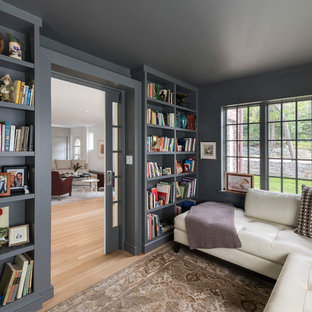 Family room - small transitional enclosed medium tone wood floor and brown floor family room idea in Boston with gray walls