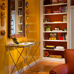 Example of a transitional family room design in San Francisco with yellow walls