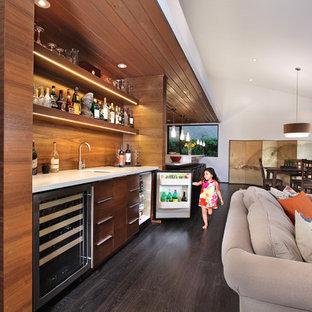 Foto di un soggiorno minimal aperto con angolo bar