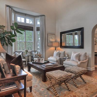 Family room - traditional enclosed medium tone wood floor family room idea in Orange County with gray walls