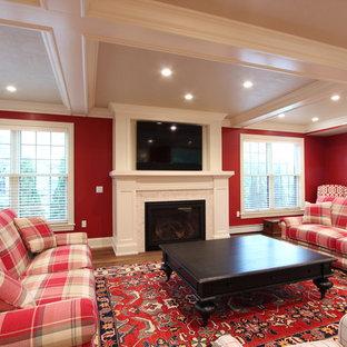 Foto di un grande soggiorno classico chiuso con pareti rosse, pavimento in legno massello medio, camino classico, cornice del camino piastrellata, TV a parete e pavimento marrone