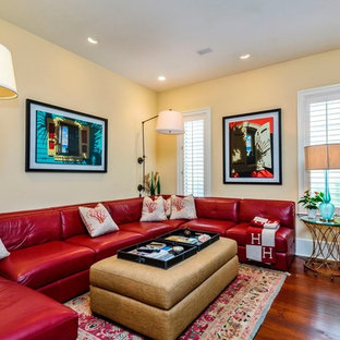 Example of a large transitional open concept medium tone wood floor and brown floor family room design in DC Metro with yellow walls, a ribbon fireplace, a tile fireplace and a tv stand