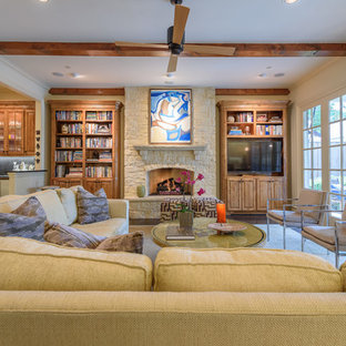 Example of a large classic open concept dark wood floor and brown floor family room design in Dallas with a bar, beige walls, a standard fireplace, a stone fireplace and a tv stand