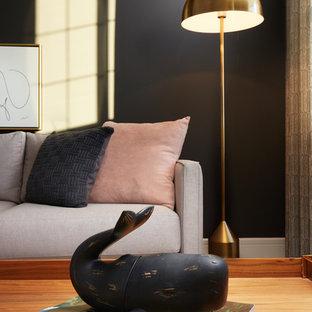 Foto de sala de estar tipo loft, clásica renovada, pequeña, con paredes negras, moqueta y suelo beige
