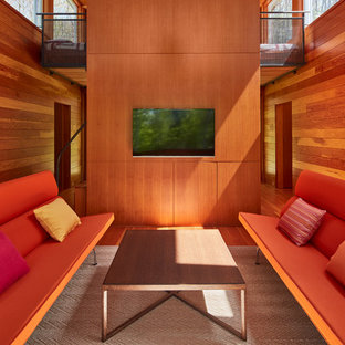 Family room - contemporary medium tone wood floor family room idea in Chicago with a wall-mounted tv