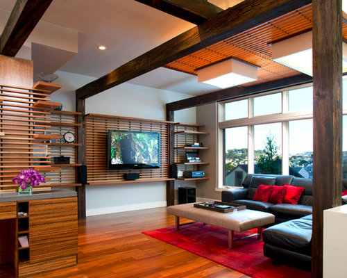 living room tv wall design. Trendy medium tone wood floor family room photo in San Francisco with gray  walls and a Tv Wall Design Houzz