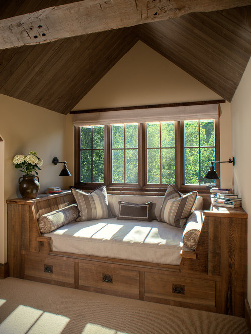 example of a mid sized mountain style family room design in other with beige walls