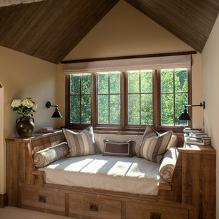Inspiration for a mid-sized country family room in Other with beige walls and carpet.