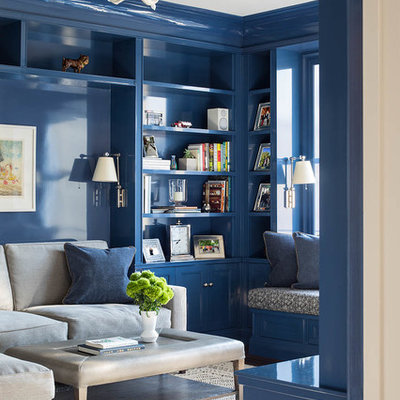Transitional beige floor family room photo in New York with blue walls