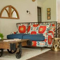 Rustic Family Room by jamesthomas, LLC