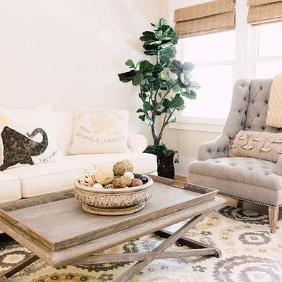 Family room - country light wood floor family room idea in Sacramento with beige walls