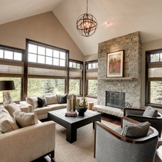 Transitional Family Room by Eskuche Design
