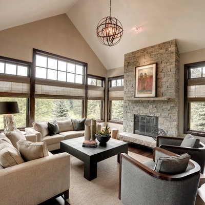 Family room - transitional dark wood floor family room idea in Minneapolis with beige walls, a standard fireplace and a stone fireplace