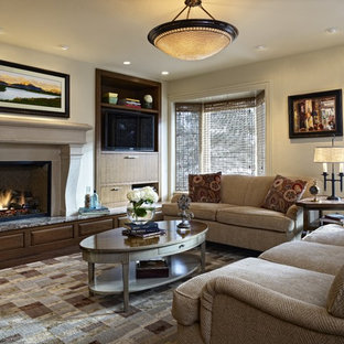 Elegant dark wood floor family room photo in Denver with beige walls, a standard fireplace, a stone fireplace and a media wall