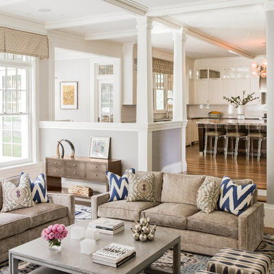 Example of a large transitional open concept medium tone wood floor and brown floor family room design in Boston with gray walls and no tv