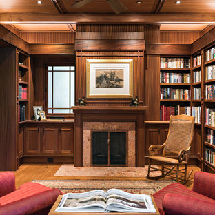 Family room library - asian enclosed medium tone wood floor and brown floor family room library idea in Boston with brown walls and a standard fireplace