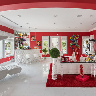 Mid-sized eclectic enclosed porcelain floor and white floor family room photo in Las Vegas with a bar, red walls, no fireplace and a media wall