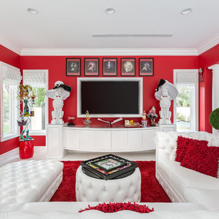 Inspiration for a mid-sized eclectic enclosed porcelain floor and white floor family room remodel in Las Vegas with red walls and a media wall