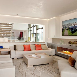 Mid-sized trendy open concept family room photo in Orange County with white walls, a wall-mounted tv, a ribbon fireplace and a concrete fireplace