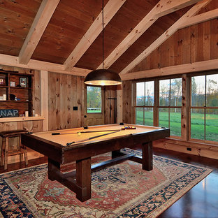 Example of a mountain style concrete floor game room design in Chicago