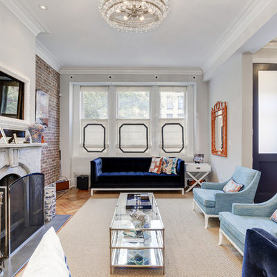 Inspiration for a victorian open concept light wood floor family room remodel in Seattle with gray walls, a standard fireplace and a wall-mounted tv