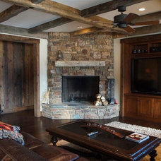 Rustic Family Room by Porth Architects, Ltd.