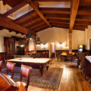 Example of a tuscan family room design in Phoenix