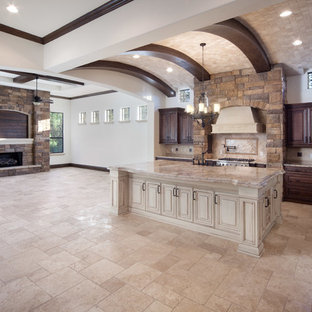 Design ideas for a large mediterranean open concept family room in Orlando with beige walls, travertine floors, a standard fireplace, a stone fireplace surround and a wall-mounted tv.