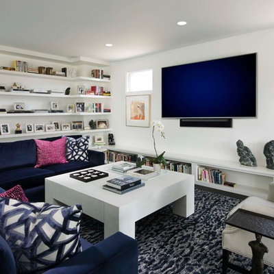 Inspiration for a mid-sized contemporary enclosed dark wood floor and brown floor family room remodel in Phoenix with white walls and a wall-mounted tv