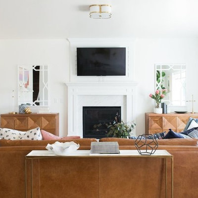 Example of a mid-sized transitional open concept medium tone wood floor family room design in Salt Lake City with white walls, a standard fireplace, a stone fireplace and a wall-mounted tv