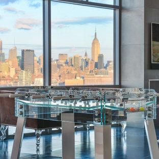 ニューヨークの中くらいのインダストリアルスタイルのおしゃれなオープンリビング (ゲームルーム、セラミックタイルの床、横長型暖炉、コンクリートの暖炉まわり、壁掛け型テレビ) の写真