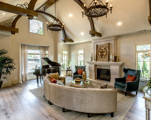 Attirant Inspiration For A Mediterranean Medium Tone Wood Floor And Brown Floor Living  Room Remodel In Los