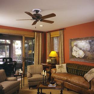 Diseño de sala de estar tradicional con parades naranjas