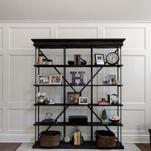 Aménagement d'une grand salle de séjour classique avec un sol en bois foncé, une cheminée standard et un manteau de cheminée en pierre.
