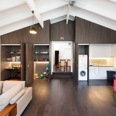 Example of a trendy open concept dark wood floor family room design in Melbourne with white walls
