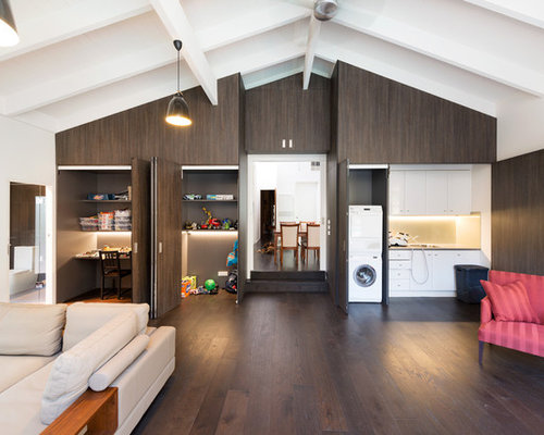 Example Of A Trendy Open Concept Dark Wood Floor Family Room Design In Melbourne With White