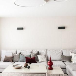 Mittelgroßes, Fernseherloses, Abgetrenntes Modernes Wohnzimmer ohne Kamin mit weißer Wandfarbe, Teppichboden und grauem Boden in Berlin