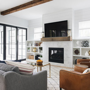 Beach style light wood floor family room photo in Chicago with white walls and a wall-mounted tv