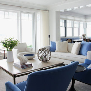 Family room - mid-sized coastal open concept family room idea in New York with white walls and no fireplace